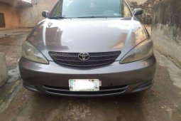 Sell cheap grey/silver 2004 Aston Martin Camry automatic in Ibadan