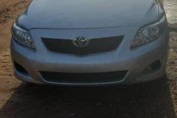 Sell well kept grey/silver 2009 Toyota Corolla sedan at price ₦2,400,000