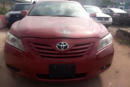 Best priced red 2011 Toyota Camry automatic