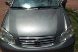 Used grey 2003 Toyota Corolla automatic at mileage 143,864 for sale