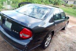 Selling grey/silver 2002 Nissan Maxima sedan automatic