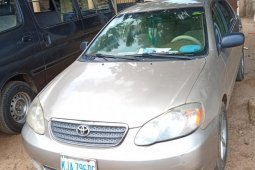 Need to sell cheap used gold 2004 Toyota Corolla at mileage 1,875,312