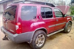 Red 2004 Nissan Xterra car at mileage 103,990 at attractive price