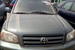 Need to sell cheap used green 2005 Toyota Highlander at mileage 75
