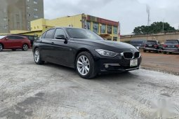 Sell cheap black 2014 BMW 328i automatic at mileage 87,000