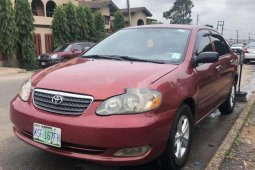Need to sell cheap used red 2006 Toyota Corolla sedan in Lagos