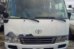Clean and neat white 2012 Toyota Coaster van / minibus at price ₦12,500,000 in Lagos