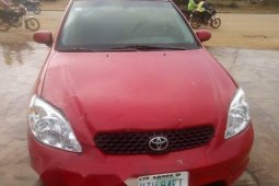 Locally Used 2004 Red Toyota Matrix for sale in Lagos.