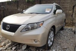 Foreign Used 2011 Gold Lexus RX for sale in Lagos