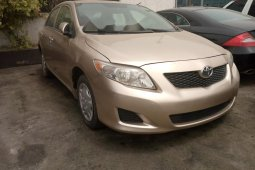 Foreign Used 2009 Gold Toyota Corolla for sale in Lagos.