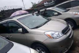 Foreign Used 2005 Gold Toyota Sienna for sale in Lagos