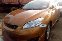 Foreign Used 2010 Gold Toyota Matrix Sport for sale in Lagos