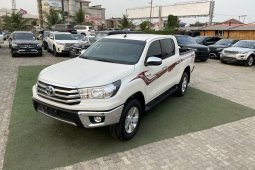 Brand New 2019 White Toyota Hilux for sale in Lagos.