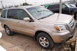 Foreign Used 2006 Gold Honda Pilot for sale in Lagos