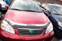 Foreign Used 2007 Red Toyota Corolla for sale in Lagos.