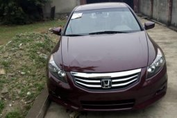 Foreign Used 2009 Maroon Honda Accord for sale in Lagos.