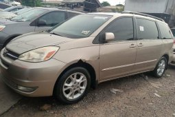 Foreign Used 2005 Gold Toyota Sienna for sale in Lagos.
