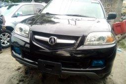 Foreign Used 2006 Black Acura MDX for sale in Lagos.