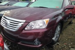 Foreign Used 2008 Maroon Toyota Avalon for sale in Lagos.