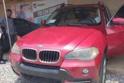 Locally Used 2008 Red BMW X5 for sale in Lagos.