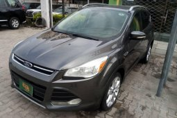 Foreign Used 2014 Dark Grey Ford Escape for sale in Lagos.
