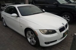 Naija Used 2009 Model White BMW 3 Series convertible for sale in Lagos.