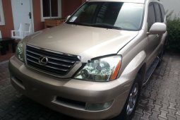 Foreign Used 2009 Gold Lexus GX for sale in Lagos.