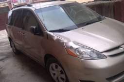 Foreign Used 2006 Gold Toyota Sienna for sale in Lagos.