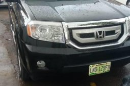 Locally Used 2011 Black Honda Pilot for sale in Lagos.