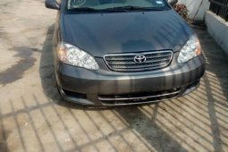 Foreign Used 2004 Black Toyota Corolla for sale in Lagos.