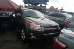Foreign Used 2010 Gold Toyota RAV4 for sale in Lagos.