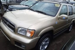 Foreign Used 2002 Gold Nissan Pathfinder for sale in Lagos.