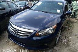 Foreign Used 2009 Dark Blue Honda Accord for sale in Lagos.
