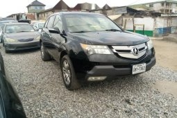 Foreign Used 2008 Black Honda Acura MDX for sale in Lagos.
