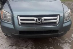 Foreign Used 2006 Blue Honda Pilot for sale in Lagos.