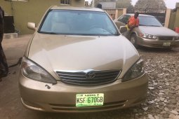 Locally Used 2004 Gold Toyota Camry for sale in Lagos.