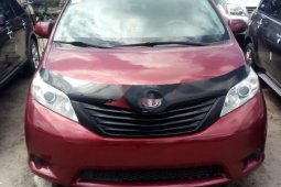 Foreign Used 2013 Maroon Toyota Sienna for sale in Lagos.