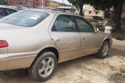 Locally Used 2002 Gold Toyota Camry for sale in Lagos.