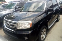 Foreign Used 2010 Black Honda Pilot for sale in Lagos.