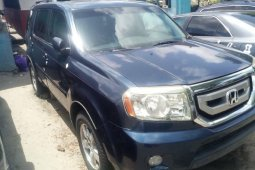 Foreign Used 2010 Blue Honda Pilot for sale in Lagos.