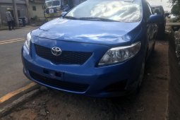 Foreign Used 2010 Blue Toyota Corolla for sale in Lagos.