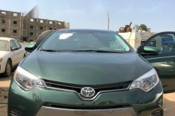Foreign Used 2016 Green Toyota Corolla for sale in Abuja.