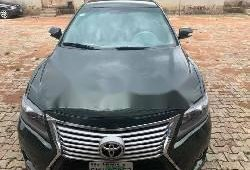 Nigerian Used 2009 Dark Green Toyota Camry for sale in Lagos.