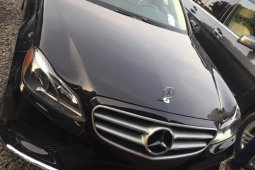 Foreign Used 2014 Black Mercedes-Benz E350 for sale in Abuja.
