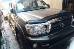 Foreign Used 2010 Gold Toyota Tacoma for sale in Lagos.