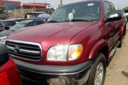 Foreign Used 2003 Maroon Toyota Tundra for sale in Lagos.