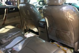 Foreign Used 2012 Red Toyota Highlander for sale in Lagos.