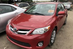 Foreign Used 2012 White Toyota Corolla for sale in Lagos.