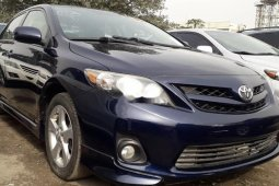 Foreign Used 2011 Blue Toyota Corolla for sale in Lagos.