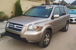 Foreign Used 2007 Gold Honda Pilot for sale in Lagos.